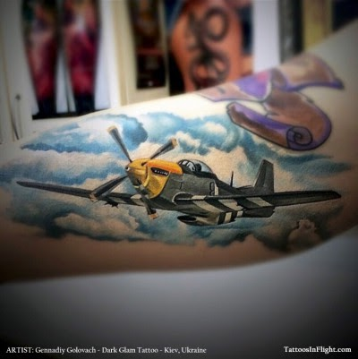 New school style colored arm tattoo of very detailed WW2 fighter plane