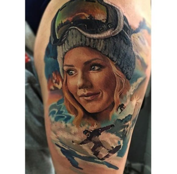 Illustrative style colored shoulder tattoo of cute woman with snowboarder