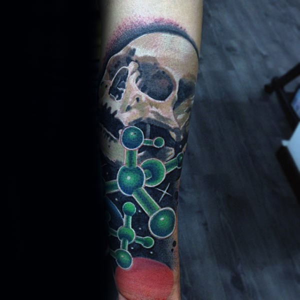 New school style colored forearm tattoo of human skull in space