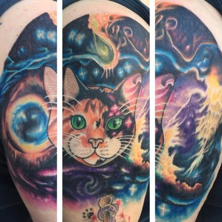 Illustrative style colored shoulder tattoo of cat combined with space and planets