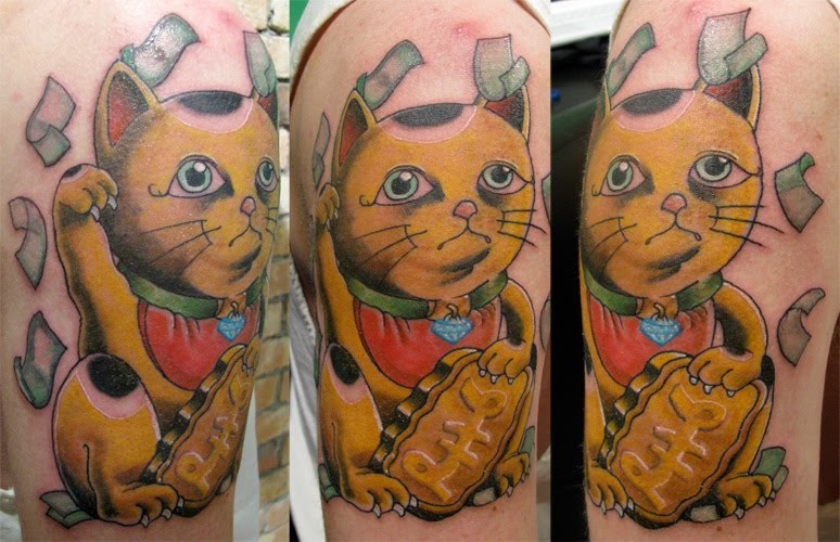 New school style colored shoulder tattoo of maneki neko japanese lucky cat with money and stone tablet
