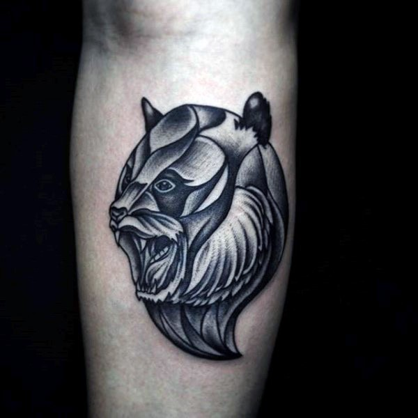 Illustrative style colored arm tattoo of evil bear