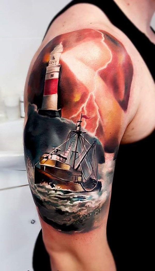 Illustrative style colored shoulder tattoo of sailing ship with lighthouse
