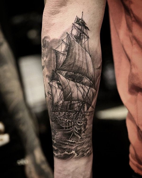 Illustrative style colored arm tattoo of large pirate sailing ship