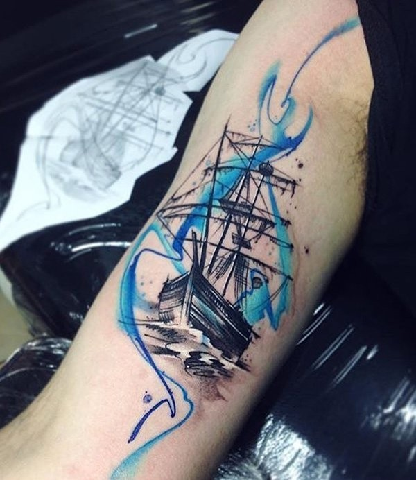 Illustrative style colored arm tattoo of sailing ship with ornaments