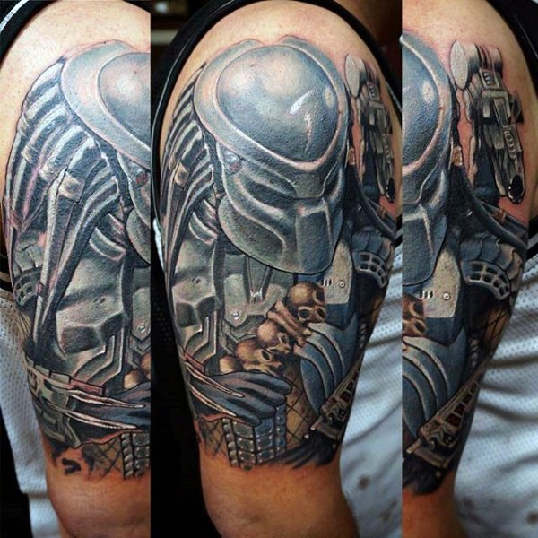 Illustrative style colored shoulder tattoo of Predator with human skulls