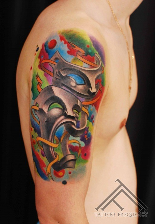 Illustrative style colored shoulder tattoo of happy and sad masks