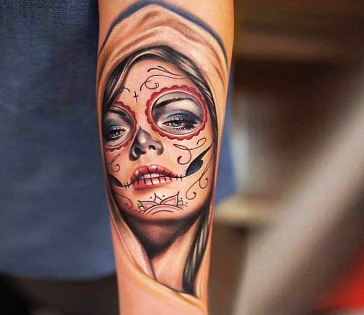 New school style colored forearm tattoo of Mexican traditional face