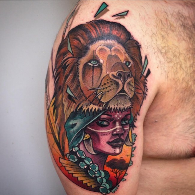 New school style colored shoulder tattoo of tribal woman with lion helmet