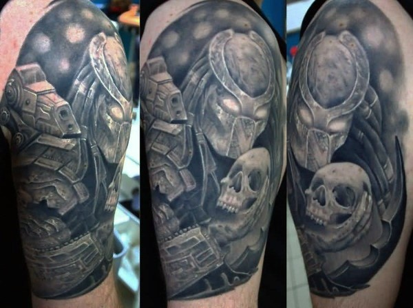 Illustrative style colored shoulder tattoo of Predator with human skull