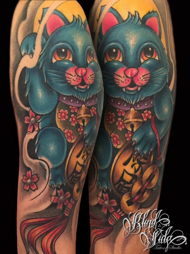 New school style colored shoulder tattoo of maneki neko japanese lucky cat with flowers and fantasy totem