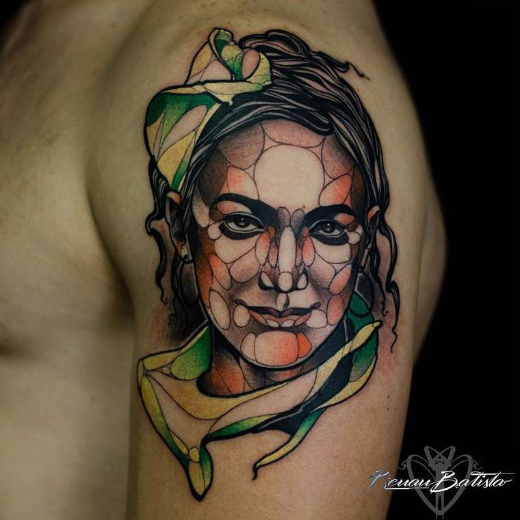 Illustrative style colored shoulder tattoo of smiling woman face
