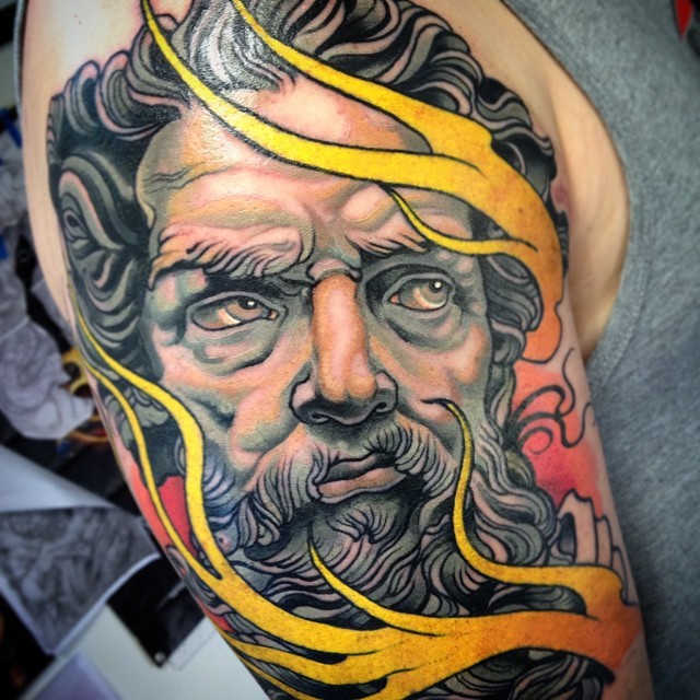 Illustrative style colored shoulder tattoo of ancient statue