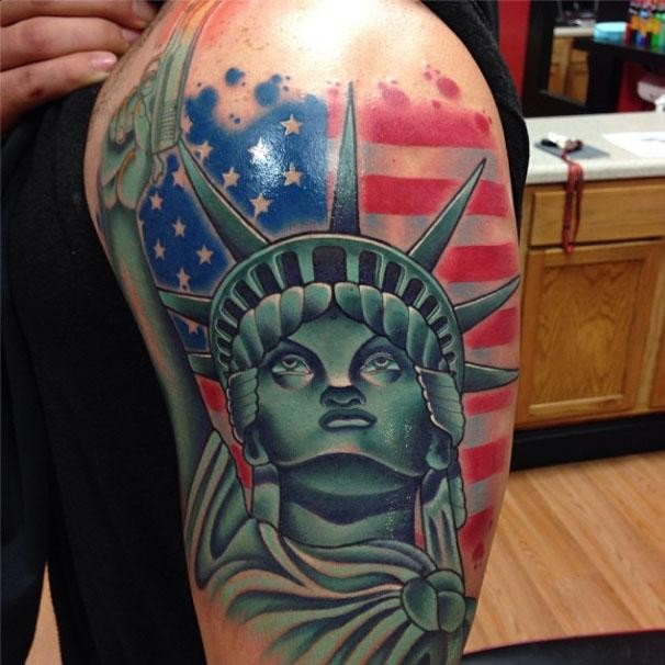 Illustrative style colored shoulder tattoo of Statue of Liberty