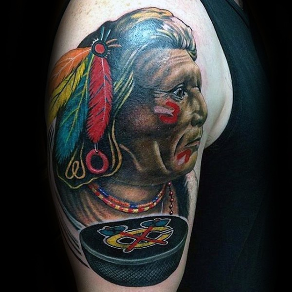 Illustrative style colored shoulder tattoo of old Indian face with hokey puck