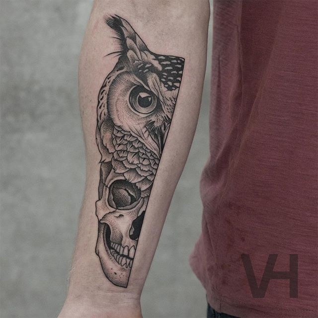 Unreal looking black ink forearm tattoo of split owl and human head by Valentin Hirsch