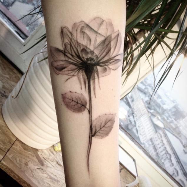 Unusual 3D like black ink forearm tattoo of beautiful flower