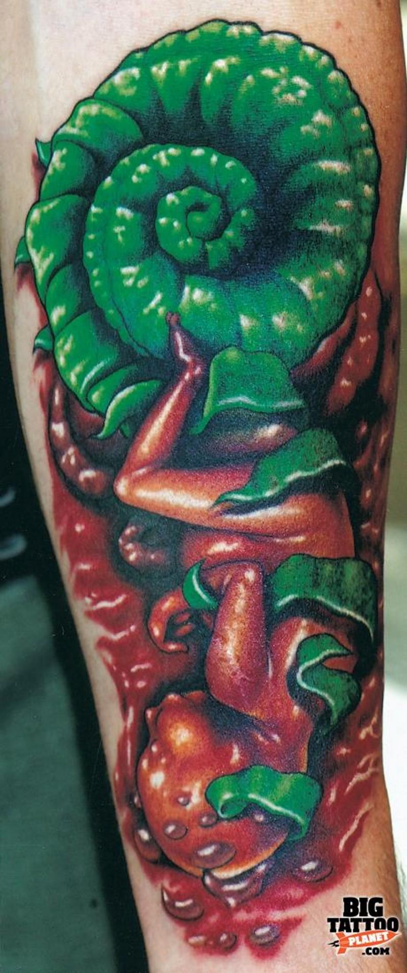 Unusual 3D like human embryo tattoo on arm