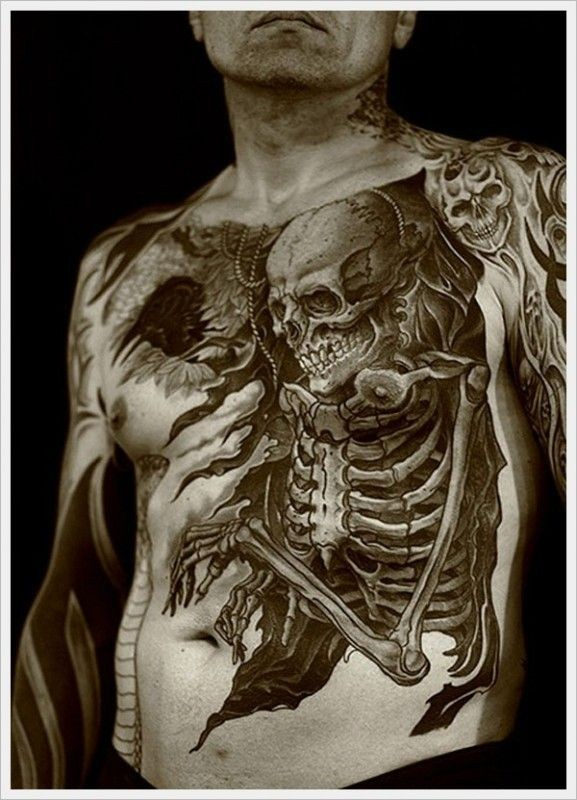 Unusual black and white human skeleton tattoo on whole chest