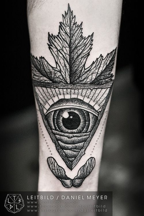 Unusual black and white Masonic pyramid like tattoo on arm