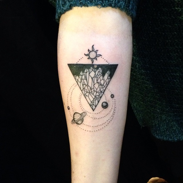 Unusual black ink forearm tattoo of solar system with triangle stylized with crystals