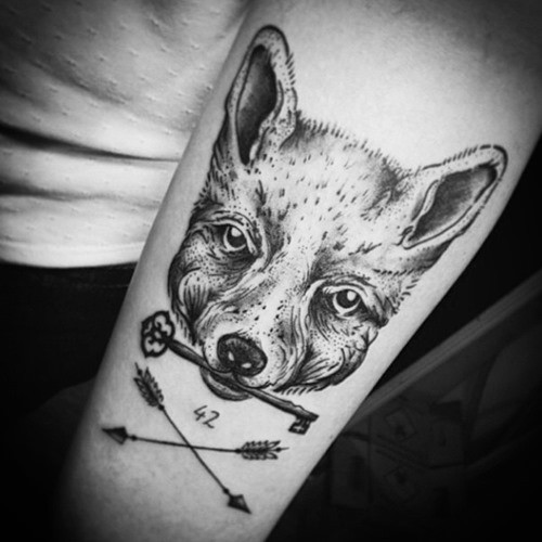 Unusual black ink fox with key tattoo on forearm combined with crossed arrows