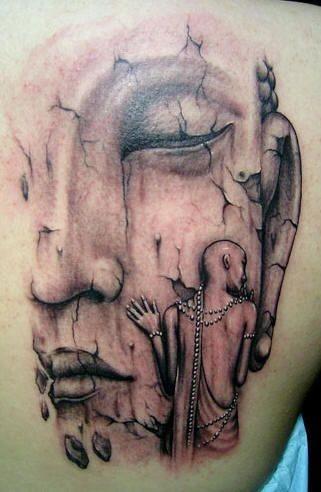 Unusual buddhist tattoo on back
