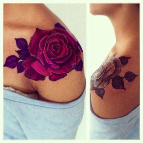 Unusual colored big rose tattoo on shoulder