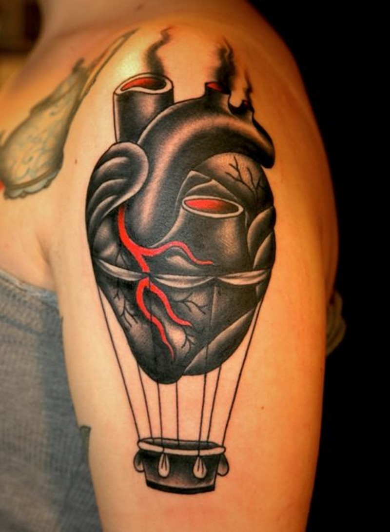 Unusual colored heart shaped balloon upper arm tattoo