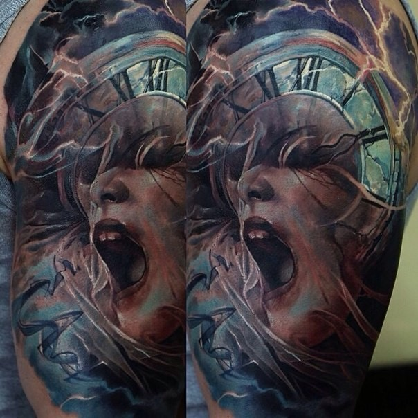 Unusual colored horror style shoulder tattoo of screaming woman with old clock