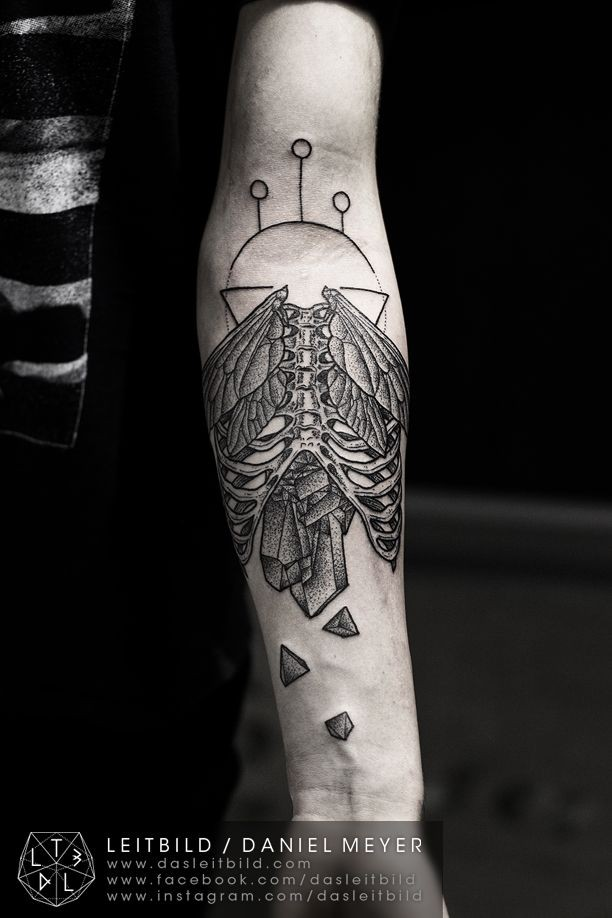 Unusual combined black and white skeleton with wings and broken stone tattoo on arm