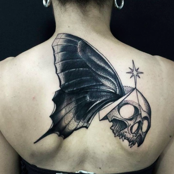 Unusual combined by Michele Zingales upper arm tattoo of human skull with butterfly wing