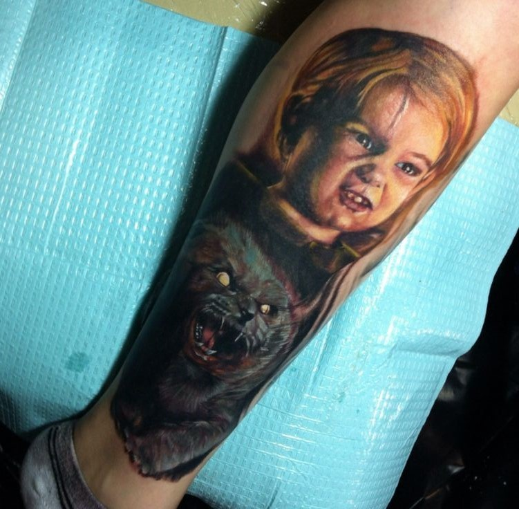 Unusual combined colored funny boy with creepy monster cat tattoo on leg