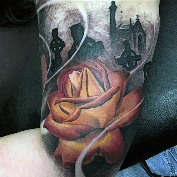 Unusual combined colored rose flower on dark cemetery arm tattoo