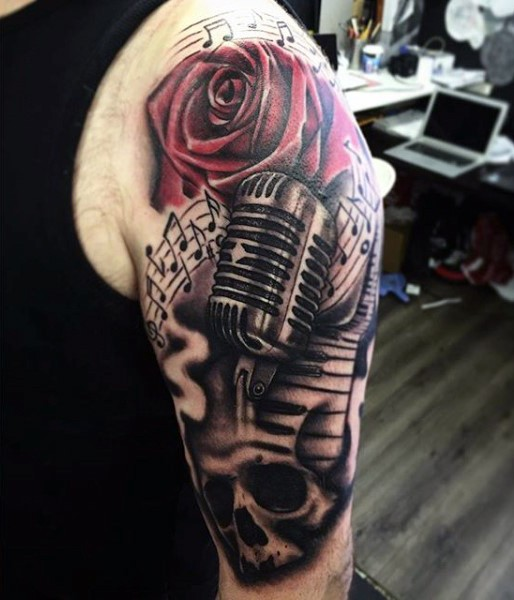 unusual combined colored vintage microphone tattoo on shoulder with flowers and skull. Black Bedroom Furniture Sets. Home Design Ideas