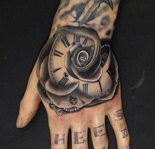 Unusual combined half rose half flower tattoo on hand