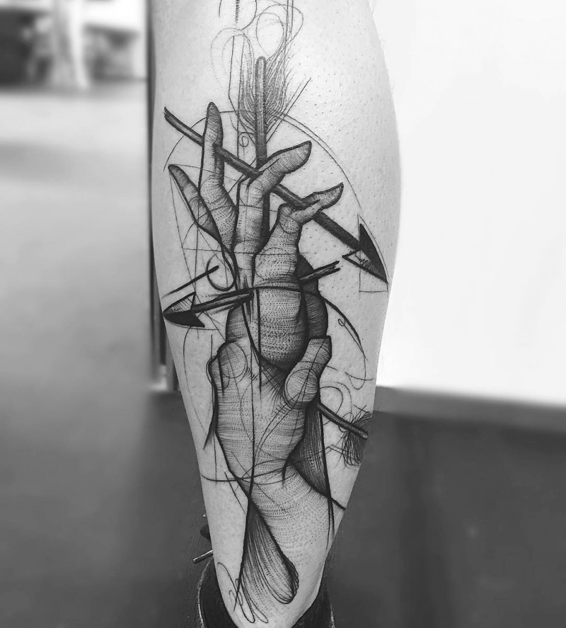 Unusual combined mystical black ink hands combined with arrows tattoo on leg muscle