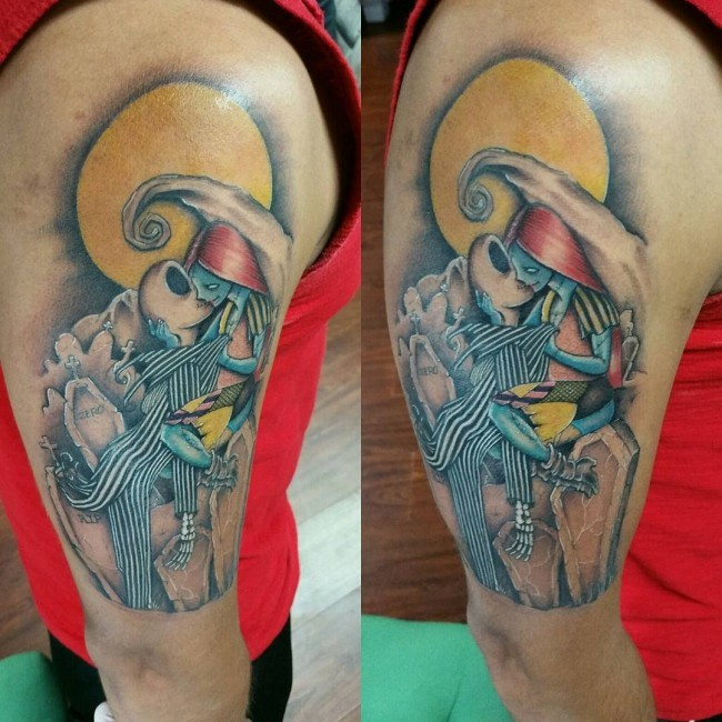 Unusual designed and colored arm tattoo of kissing monster couple