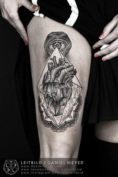 Unusual designed big black and white mystical cult tattoo on thigh