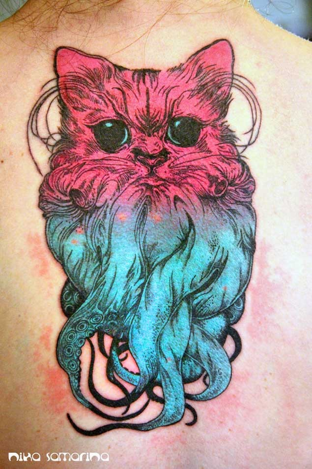 Unusual designed big colorful cat shaped octopus tattoo on upper back
