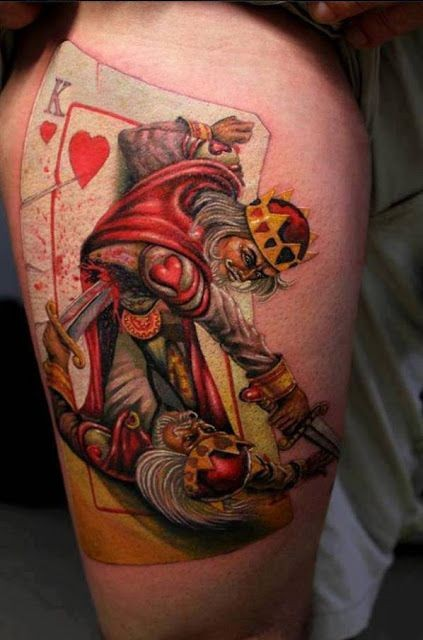 Unusual designed colored fighting playing card kings tattoo on thigh