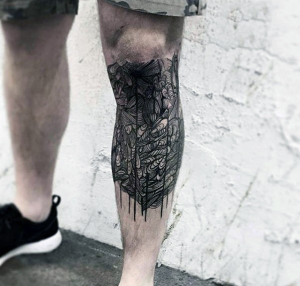 Unusual designed little black and white mystic tattoo on leg