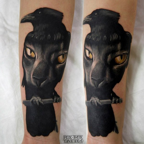 Unusual looking colored black crow tattoo on forearm stylized with cat face