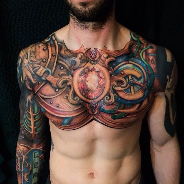 Unusual painted and colored nice looking chest and sleeve tattoo of fantasy armor with lettering