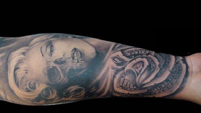e3fd6aaefc896 Unusual painted black ink Marilyn Monroe tattoo on forearm with rose made  from dollar bill
