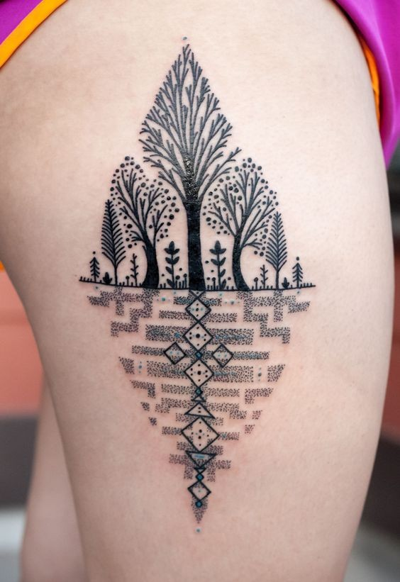 Unusual painted black ink trees tattoo on thigh with geometrical ornaments