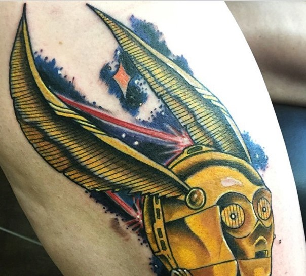 Unusual painted cartoon like colored C3PO droid tattoo on thigh
