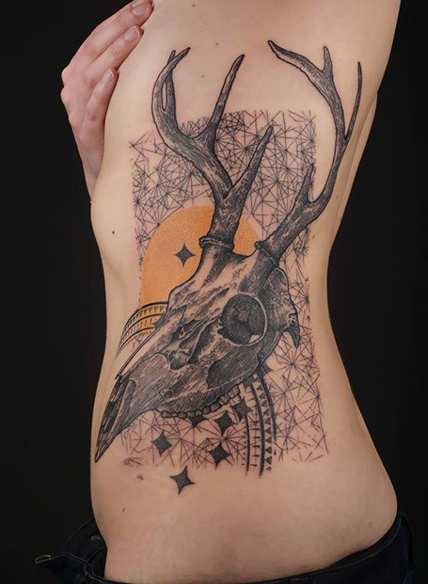 Unusual style combined black ink geometrical tattoo with animals skull tattoo on side