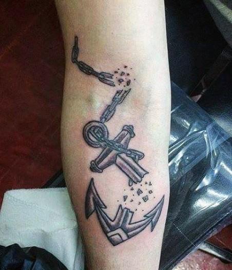 insolito stile disegno ancora spezzata tatuaggio su braccio