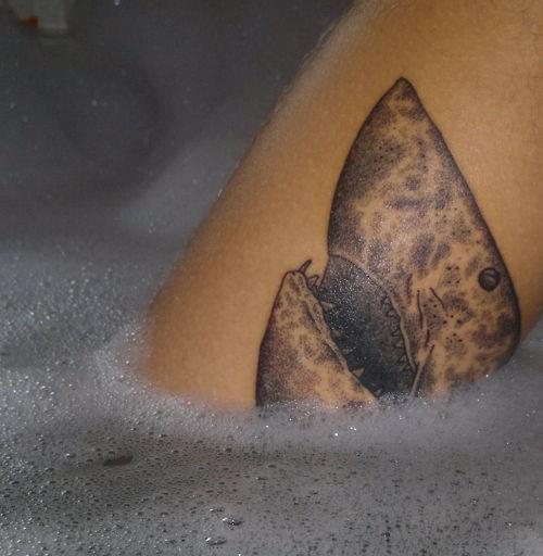 Unusual style painted black and white shark head tattoo on leg